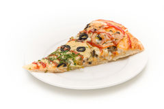 Slice of pizza on a white plate. Isolated Royalty Free Stock Photography