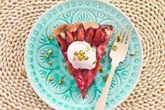Slice of plum pie Stock Photo