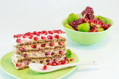 Slice of pomegranate cake Stock Images