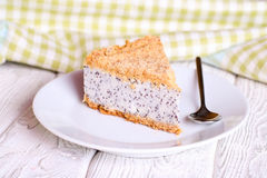 Slice of poppy seed cake on a white plate Royalty Free Stock Photo