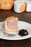 Slice of pork pie with fork Royalty Free Stock Images