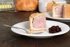 Slice pork pie with relish Stock Photo