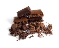 Pieces of black and chocolate porous chocolate Royalty Free Stock Photo