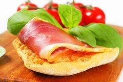 Slice of prosciutto on crispy bread Stock Photo