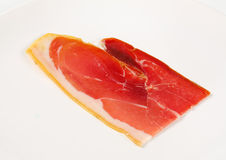 Slice of prosciutto crudo Stock Photos