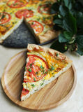 Slice of puff pastry snack pizza pie with cottage cheese Stock Image