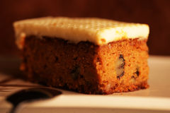 a slice of pumpkin cake on a white plate Royalty Free Stock Images