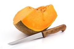Slice of pumpkin with knife Stock Photos