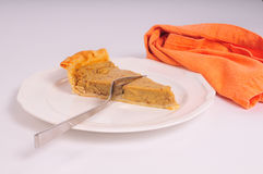 Slice of pumpkin pie Stock Image