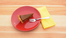 Slice of pumpkin pie on a red plate Royalty Free Stock Images