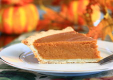Slice of pumpkin pie. At a Thanksgiving table Royalty Free Stock Photo