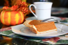 Slice of pumpkin pie royalty free stock photography