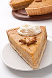 Slice of Pumpkin pie with whipped cream Royalty Free Stock Image