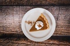 Slice of a pumpkin pie Stock Photo