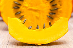 Slice of pumpkin with seeds Stock Photos