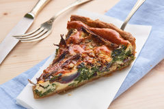 Slice of quiche tart Royalty Free Stock Images