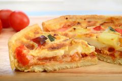 Slice of quiche on wooden board Stock Photography