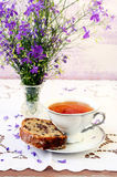 Slice of raisin cake and cup of tea Royalty Free Stock Photos