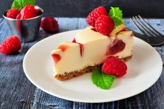 Raspberry cheesecake close up with a rustic wood background Stock Photos
