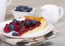Slice of raspberry pie with fresh berries. Fresh raspberry pie, tasty filling, fresh berries and coffee Stock Image