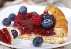 Slice of raspberry pie with fresh raspberries and blueberries. Fresh raspberry pie, tasty filling, fresh raspberries and blueberries Royalty Free Stock Photo