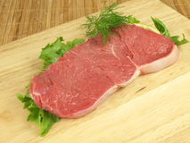 Slice of raw beef Royalty Free Stock Photo