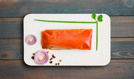 Slice of raw red fish, sea chum on white wooden Board, healthy eating, top view,. Copy space Stock Photo