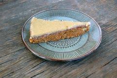 Slice of raw vegan carrot cake with cashew cream Royalty Free Stock Image