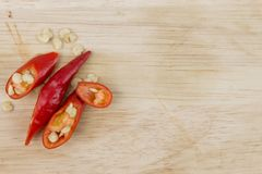 Slice red chili pepper on wood cutting board Stock Images