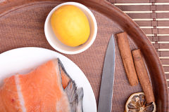Slice of red fish salmon with fruits and cinnamon Royalty Free Stock Images