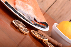 Slice of red fish salmon with fruits and cinnamon Royalty Free Stock Photo