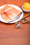 Slice of red fish salmon with fruits and cinnamon Stock Photos