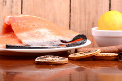 Slice of red fish salmon with fruits and cinnamon Royalty Free Stock Photography