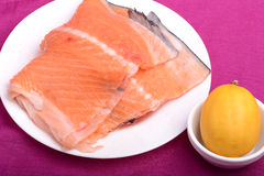Slice of red fish salmon with fruits Stock Images