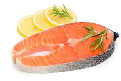 Slice of red fish salmon with lemon and rosemary isolated on white background.  Stock Images