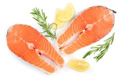 Slice of red fish salmon with lemon and rosemary isolated on white background. Top view. Flat lay.  Stock Images