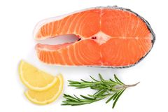 Slice of red fish salmon with lemon and rosemary isolated on white background. Top view. Flat lay.  Royalty Free Stock Images