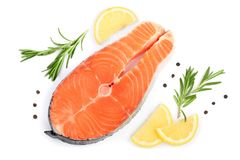 Slice of red fish salmon with lemon, rosemary and peppercorns isolated on white background. Top view. Flat lay.  Stock Photo