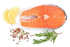 Slice of red fish salmon with lemon, rosemary and peppercorns  on white background. Top view. Flat lay.  Stock Photo