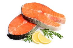 Slice of red fish salmon with lemon and rosemary  on white background.  Stock Photo