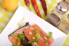 Slice of red fish salmon with red pepper Royalty Free Stock Photography