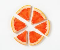 Slice of red grapefruit Stock Photography