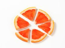 Slice of red grapefruit Royalty Free Stock Photos