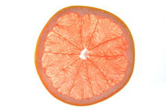 Slice of red grapefruit Royalty Free Stock Images