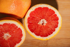 Slice red grapefruit Stock Photography