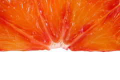 Slice red orange closeup. Orange background. Space for text. Royalty Free Stock Photo