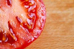 Slice of red ripe tomato Stock Photo