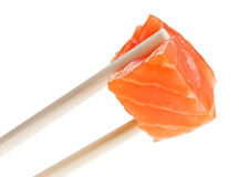 Slice of red salmon fish in chopsticks Royalty Free Stock Image