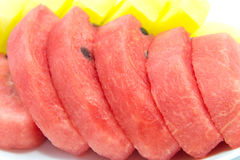 Slice of red and yellow watermelon Stock Photography