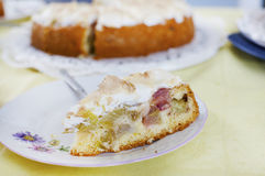 Slice of rhubarb cake with meringue topping Stock Image